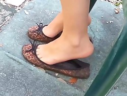 teen in flats shoeplay